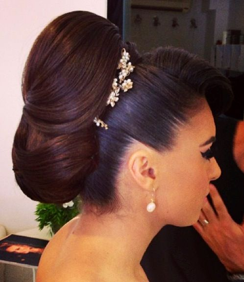 A gorgeous, full-body, high and intricate bridal updo by Israeli hair and makeup artist Barak Ben-Hayun. So stunning! I love all of his work.