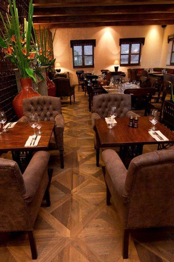 A custom-made version of our Basilica Panel floor, designed to the architect's specifications, double-smoked and produced in specific and precise sizes. El Asador Restaurant, Prague, Czech Republic