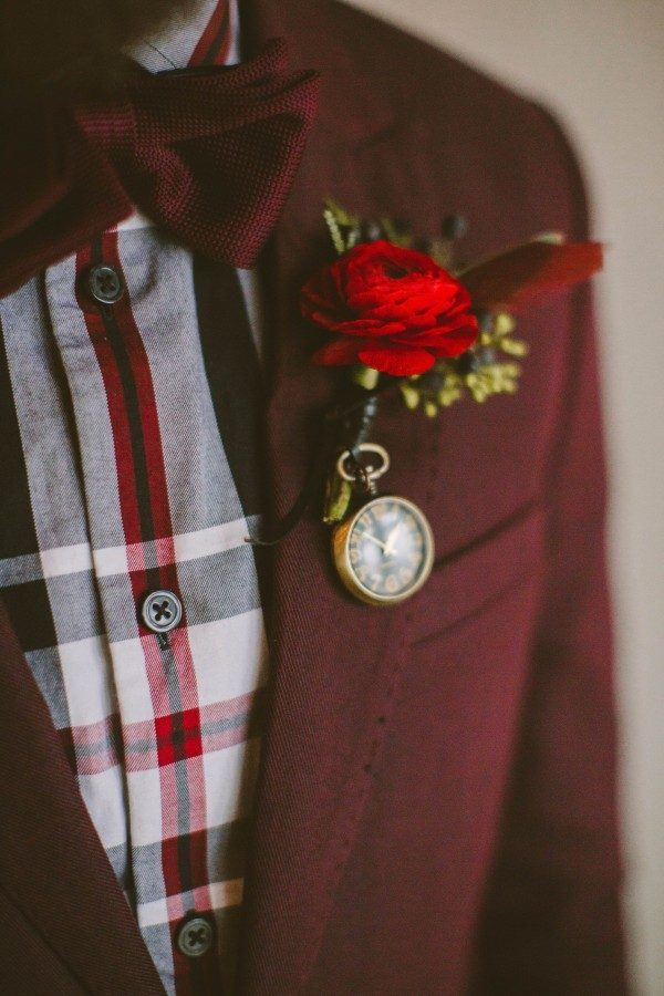 Lush red boutonniere and chic plaid for an autumn flair | Image by Hot Metal Studio
