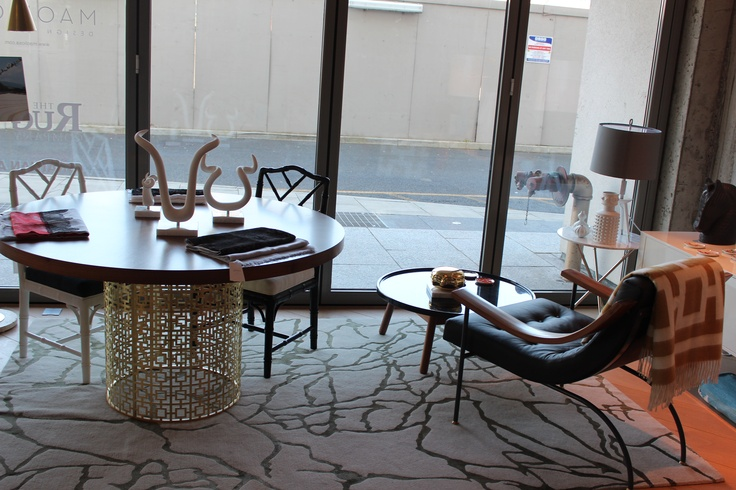 Kelly Wearstler's Tracery rug for The Rug Company, Jonathan Adler's Brass Nixon dining table, Linley's St Moritz chair...