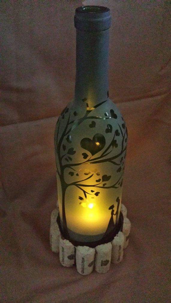 Wine Bottle Candle Shade Etched with Heart Tree After cutting the bottom of this wine bottle off, I etched a reverse heart tree design wrapping the bottle. This gives an incredible effect when you set it over top of a candle, by CronusCustoms
