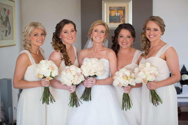 Sally's bridesmaids wore our Stella gown in champagne with additional straps - Available at Bridesmaids Only