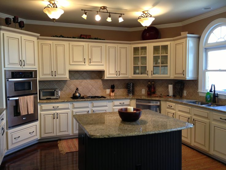 My dream kitchen, at last!; Painted maple cabinets antique white/almond; added light rail at the bottom and rope crown moulding at the top; chocolate brown pen glaze; Island contrast and painted chocolate brown with darker glaze (Faux to Finish); walls are Sherwin Williams Mexican Sand