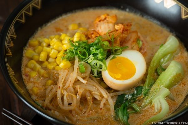 Spicy and rich vegetarian ramen recipe made with soy milk, vegetarian dashi, and topped with ramen egg, spicy bean sprouts, and corn.