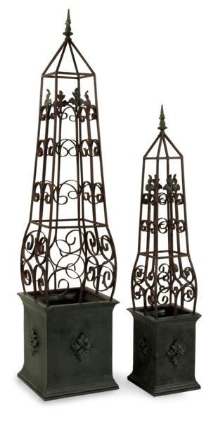 """Antique Topiaries - Set of 2 - Antiqued, hand wrought iron topiaries . Material: 100% iron. 45-59""""h x 8.75-12.25""""w x 8.75-12.25""""."""