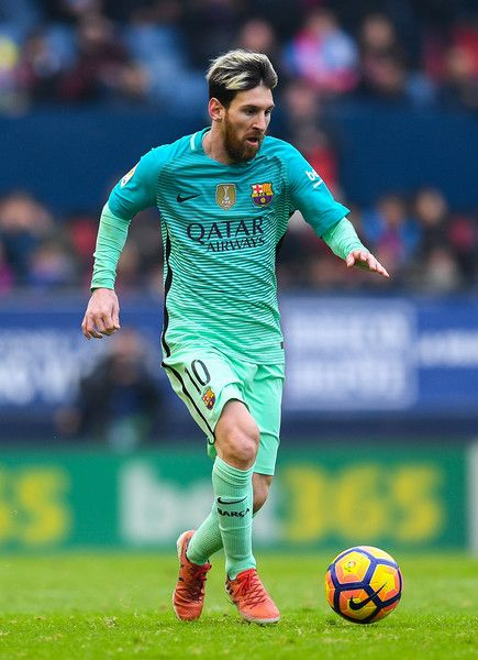 Lionel Messi of FC Barcelona runs with the ball during the La Liga match between CA Osasuna and FC Barcelona at Sadar stadium on December 10, 2016 in Pamplona, Spain.