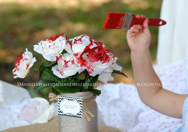 Paint the roses red at an Alice in Wonderland party! See more party ideas at CatchMyParty.com! #aliceinwonderland #partyideas