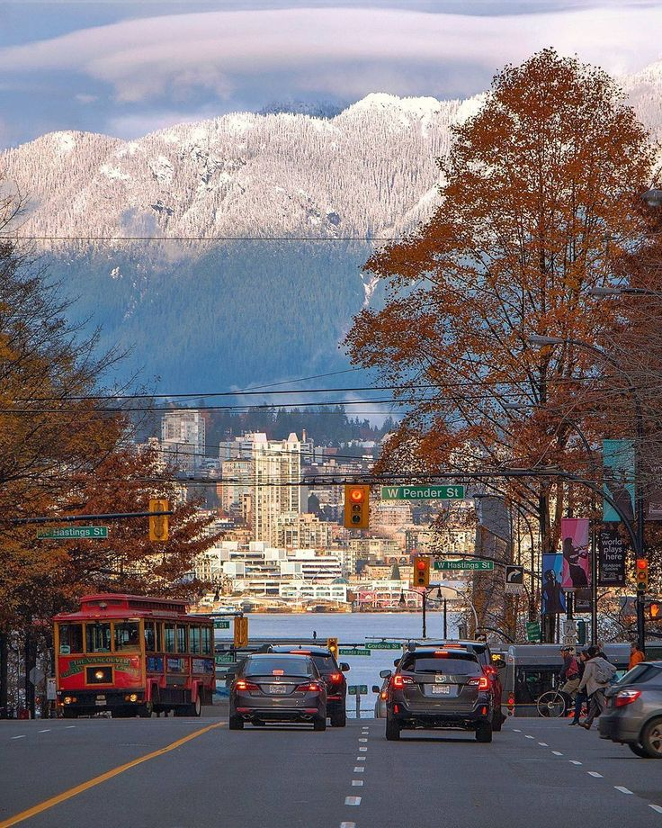 The Streets of Vancouver  . Yesterday's clouds cleared to reveal a snowcapped Mount Seymour. Looking up Burrard Street from Dunsmuir to W. Pender, W. Hastings, W. Cordova, Canada Place, over Vancouver Harbour to Lonsdale Quay on the shore of North Vancouver. Captured Downtown Vancouver, British Columbia, Canada ~ November 17, 2017