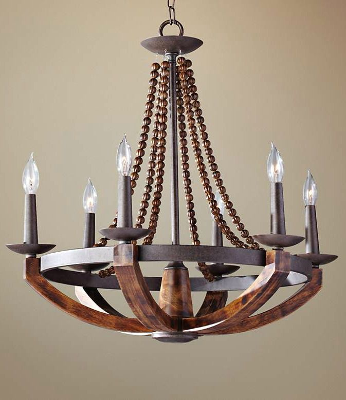 Transitional six-light chandelier  inspired by classic Old World designs and updated with beading and a warm faux wood finish.