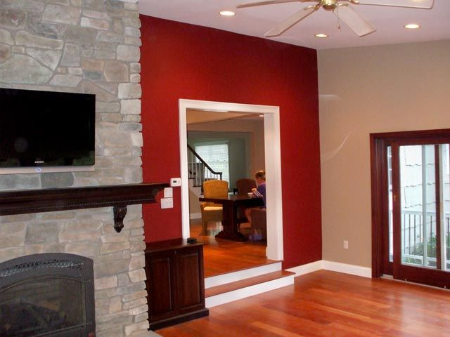 Red Accent Wall   Tan Walls   Wood Flooring   Our Future Living Room Colors