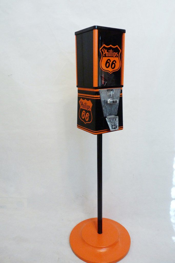 "that has been completely restored and themed to          PHILLIPS 66   This Machine comes complete with all original components including: * Machine Base & Body – Black & orange Gloss * 25 ¢ Coin Mechanism  * Lock and key  * Original candy/ nuts  wheel *Lock and Key   machine  measure approx. 40"" Tall"