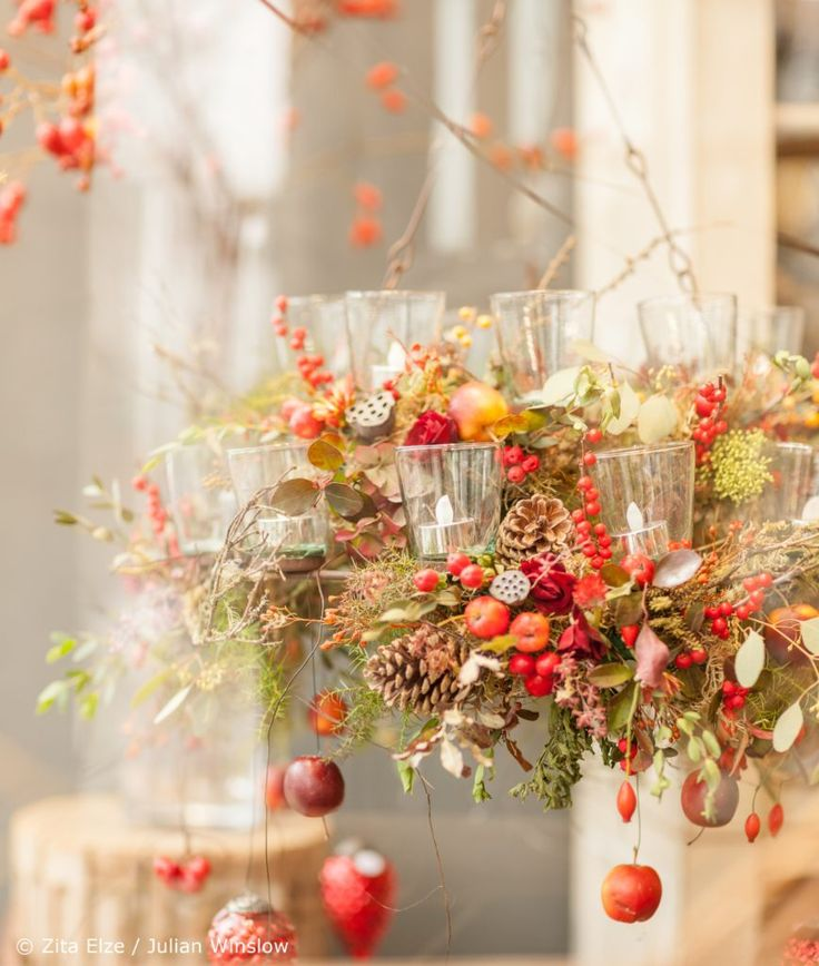 Zita Elze naturalistic floral chandelier design with twigs, fruit and flowers for Christmas shop display photo: Julian Winslow lp 25