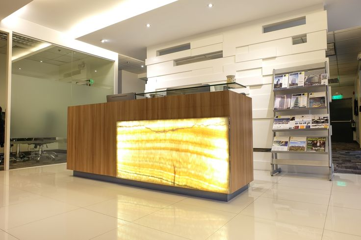 Front Desk Lobby  Idea. Our design team put the Light & Wood  with white calm color in SM Aura reception - Philipinnes