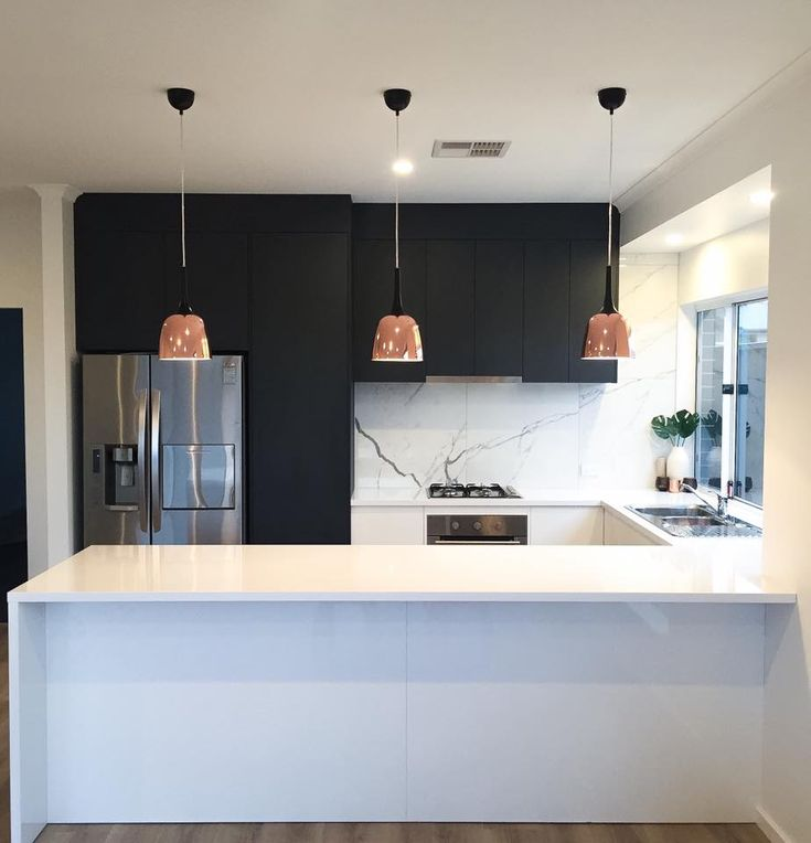 Design by Eclectic. Contemporary kitchen design using Adelaide Marble tiles, Laminex Charcoal Riven and Laminex Polar white.
