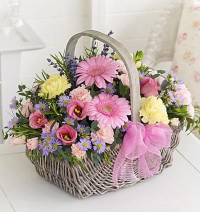 Basket of pink flowers.