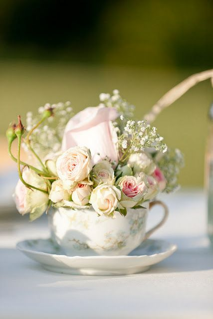 So sweet- how beautiful! Gorgeous for a baby shower. Again, thinking outside the box- using a tea cup instead of a typical flower container.