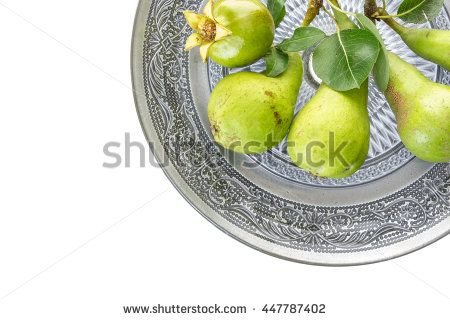 Green pears and pomegranate in oriental dish closeup,  on white background.