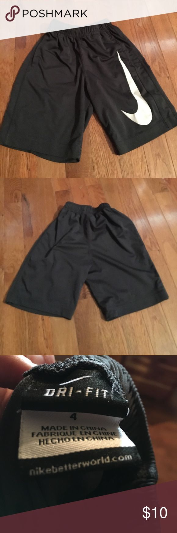 Boys Nike shorts size 4 Boys Nike shorts size 4. There is a small spot on the back of these. I don't have it shown in the photos. Otherwise, good condition. Nike Bottoms Shorts
