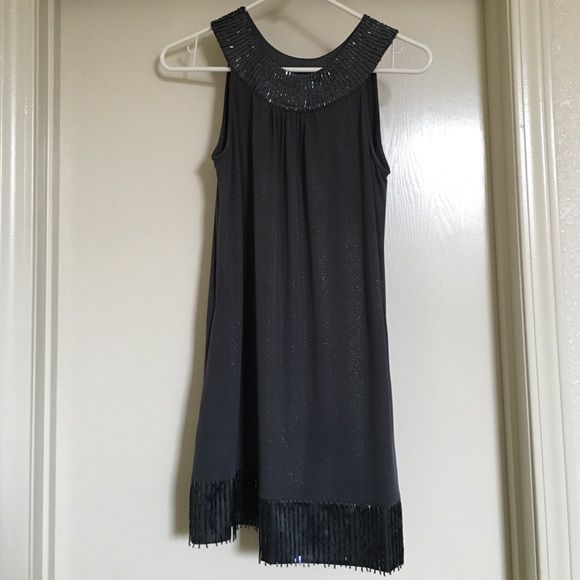 "Express Going Out Dress Express, grey, dress with shiny grey beads along the top and bottom of the dress.  The bottom line of beads are free and move as you move.  95% polyester, 5% spandex.  Only worn once, no damages!  I am 5'2"" and it falls right above my knees. Express Dresses Midi"