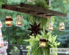 Adorable way to display hanging candles and other found objects from a section of an old wood ladder.