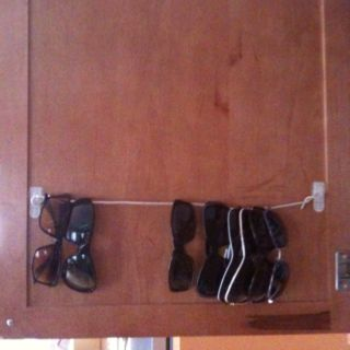 Two command hooks and a piece of twine inside a cabinet. Organize sunglasses and keep them scratch-free.: Cabinets, Business Cards, Closet Doors, Coat Closet, Command Hooks, Organizations Sunglasses, Apartment, Twine Inside, Clothespins