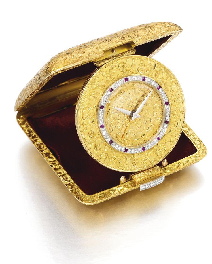 Vacheron Constantin - AN 18K YELLOW GOLD, RUBY AND DIAMOND-SET TRAVEL TIMEPIECE WITH ALARM CIRCA 1960