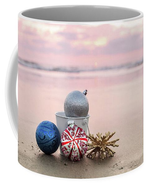 Coffee Mug featuring the photograph Christmas Decorations by Evgeniya Lystsova. Christmas Decorations at Carlsbad State Beach at sunset on the background of sea in San Diego, holiday concept. Christmas is the time of giving and receiving gifts. Have fun of finding something special for your family, husband, wife, kids and friends! More options of Art Products (Prints, Home Decor, Lifestyle) you can find in my gallery. #EvgeniyaLystsovaFineArtPhotography #Christmas #Gift #Season #Mugs…