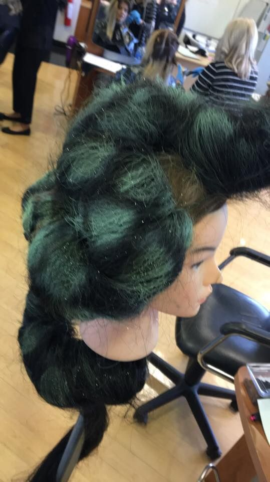 I used green hair spray colour and sprayed it over the template to create this design and effect.