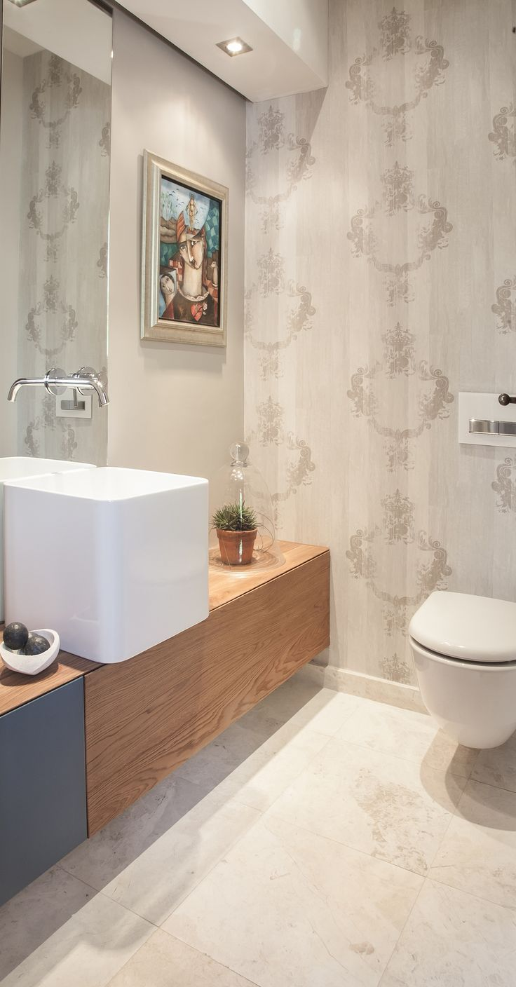 The cloakroom with the new LED lit bulk head and unusual tall basin and wall paper.