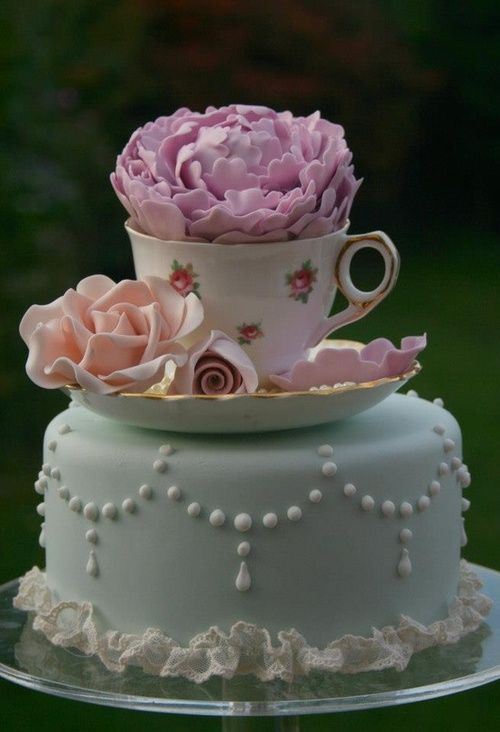 Lovely cake!  Achievable...Just buy a decorated bakery cake and plop a cup & saucer full of flowers on top!  YAY!  Farmhouse CHARMING!