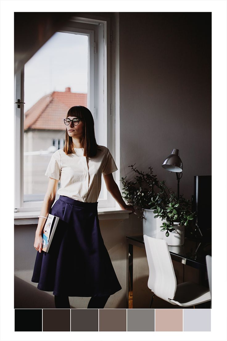POKOJÍK / Hani is holding Apartamento magazine and she wears off white perforated top by About and a woolen skirt by About.