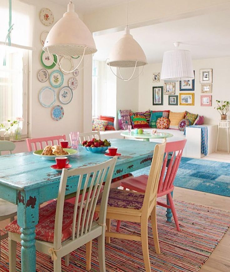 Love that colorful table and chairs!