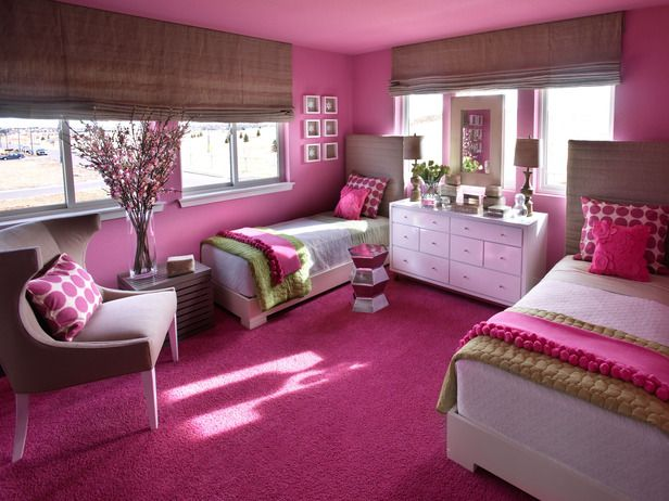 HGTV Green home girl's room: Platform-style twin beds are customized with custom-crafted headboards, slipcovered with natural linen. Wall color is Sherwin Williams Rosebay 6563. Hot pink pillows are made with Studio Bon Fuzz in Candy fabric.