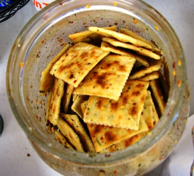 Snack Crackers -3 sleeves of saltine crackers, 1 pkg dry zesty Italian dressing, 1 pkg dry Ranch dressing,  1 T red pepper flakes, 1¼  c canola oil  shake and turn