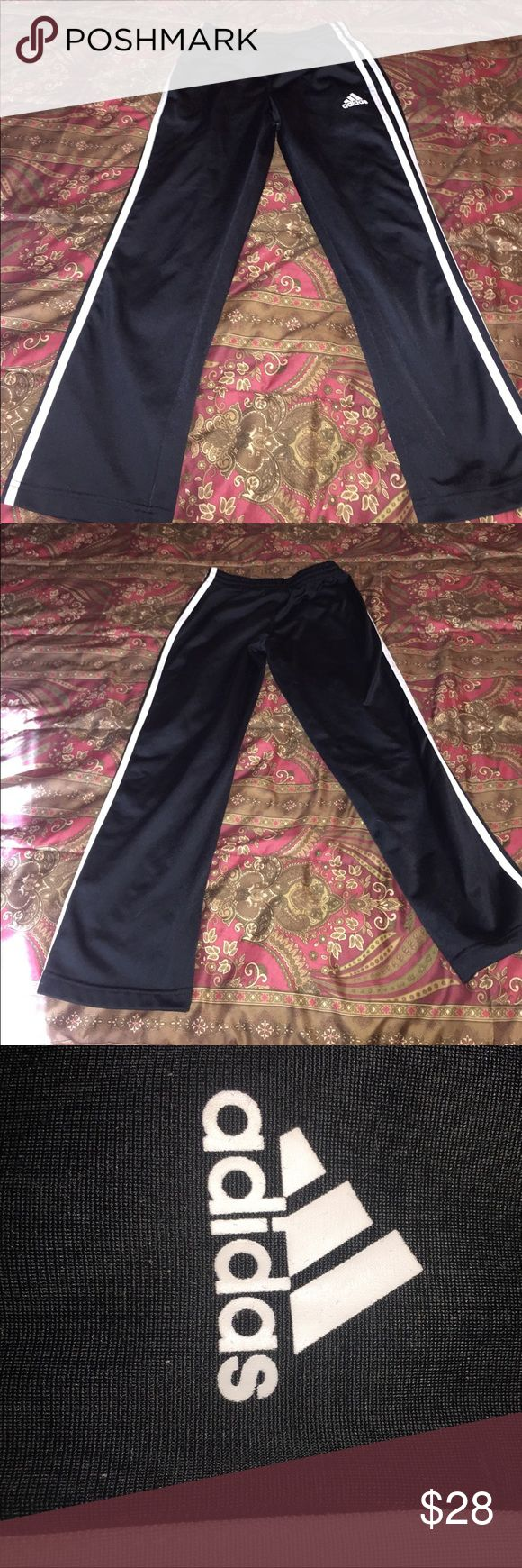 Adidas Originals Track Pants (NOT joggers) These are YOUTH small 7/8. Perfect for your little guy (or gal)! BUT fits a petite woman as well. I am 5'2 / 24/25 waist / 105 lbs and this fits just right. I like to style with a bodysuit, tight shirt tucked in, baggy shirt, or crop top. All depending on how you want to rock it!   Baggy fit with elastic waist. Low-rise. 70% cotton/30% polyester. Great condition. No flaws.NOT JOGGER STYLE PLEASE NOTE. adidas Bottoms Sweatpants & Joggers