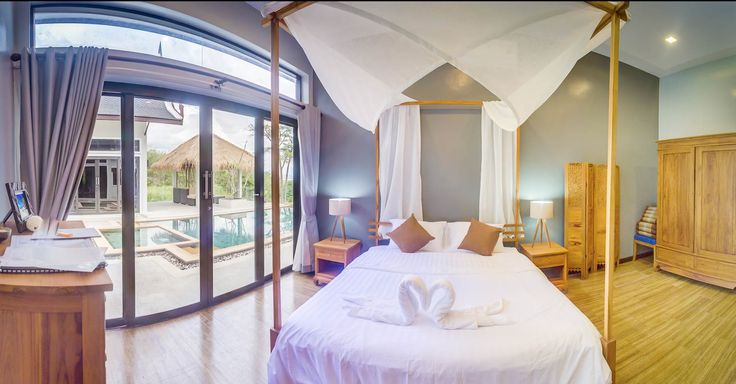 Shamballa Pool Villa on Koh Lanta Island, Krabi, Thailand. This 32sqm Master Suite #2 has direct access to the 10m swimming pool. Indonesian sandstone flooring, teak wardrobes, king sized bed and handmade bedside lamps furnish this exquisite bedroom suite.