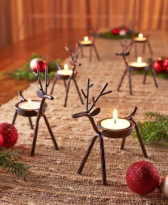 Create an adorable holiday display with Set of 6 Reindeer Tea Light Holders. Each metal reindeer has a spot on its back to hold a tea light or LED tea light candle. Keep your little herd together or s