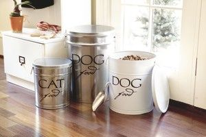 Ditch the half-empty food bags. Storing your pet's food in a specialized container with an airtight lid will help it stay fresh and easily accessible. And because these clever bins are available in all sorts of gorgeous colors and motifs, you won't even have to hide them away. Put a cute little treat jar on your kitchen counter and a larger food container, complete with handy scoop, near your pet's bowl for extra convenience.