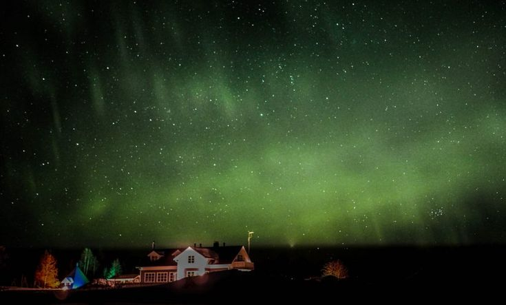 Mieko Resort in Lake Miekojärvi in Pello in Lapland under northern lights