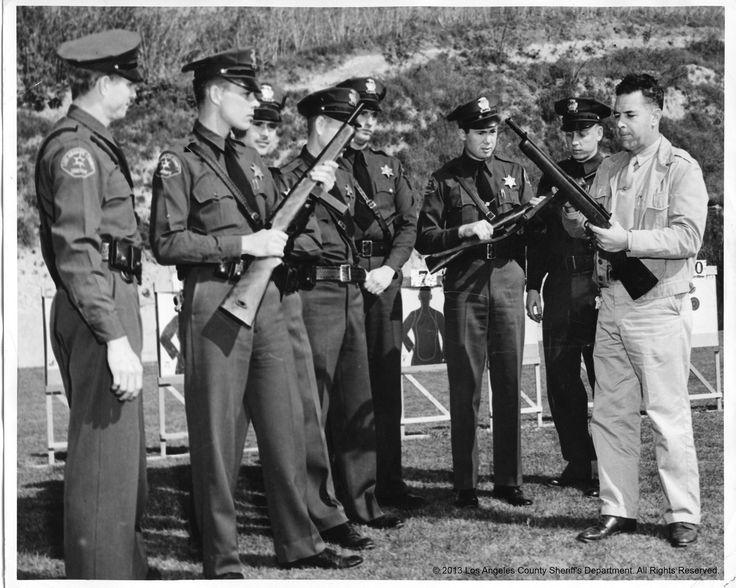 Sgt. Rile Dennison, wearing khakis, instructing deputies