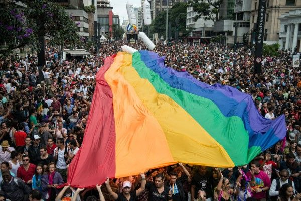 """""""Let's remember that in 80 countries it's still illegal to be gay and in ten countries or so it's a death penalty,"""" he told CBS. """"Our oppressors, our enemies if you will, the people who are trying to stop us, are formidable with their religions and their laws and their hatred."""" Gilbert Baker, the man who designed the gay pride flag"""
