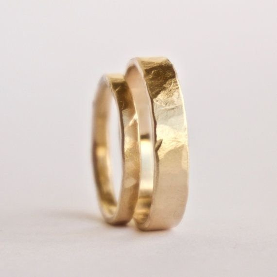 A set of matching gold wedding rings with a rustic flat hammered texture. I make these to order in my own workshop using hand tools and traditional goldsmith methods. I use a heavy flat hammer that has a lovely weathered texture to transfer irregular creases and ridges to the rings surface. There is also a subtle faceted effect as the hammer strike impacts areas of metal at slightly different angles. This set is made from 18 carat gold and will be hallmarked by the Edinburgh Assay office…