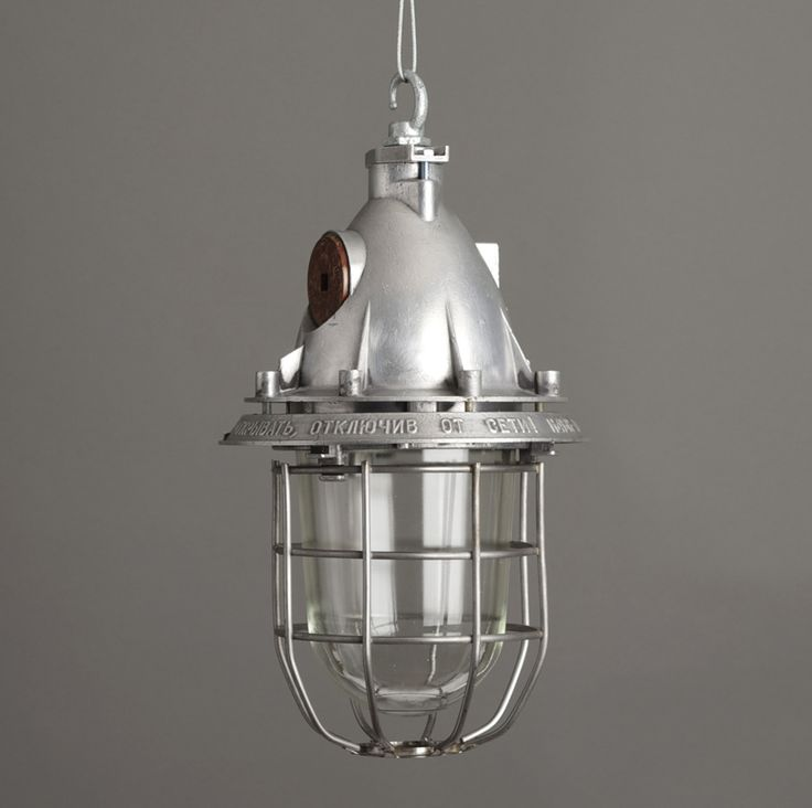 Vintage industrial pendant light salvaged from within the eastern bloc polished aluminium enclosure featuring cast