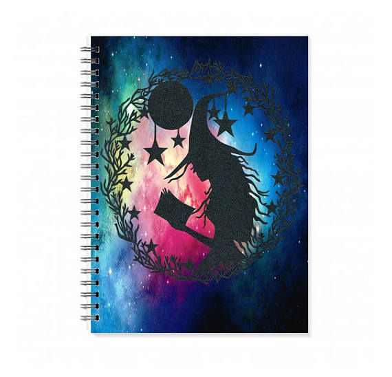 This is a 100 sheet (200 page) spiral bound notebook featuring a print of my original witch papercut. It features a reading witch surrounded by stars and the moon. The original piece has been backed on a galaxy backing and has been scanned to produce the final printed image.  The back of the book features our printed business logo.  A5 measures 5.8 x 8.3 inches and has a spiral binding.  The finish is optional with plain pages or lined sheets making a beautiful notebook, art journal or…