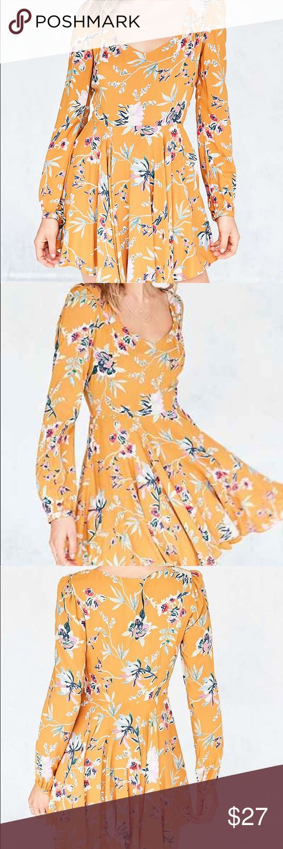 Urban Outfitters Ecote Rosalinda Long Sleeve Dress Urban Outfitters Ecote Rosalinda Floral Long Sleeve Mini Dress. Orange with pink, purple, and green floral print. Side zip enclosure. Sweetheart neckline. Fit and flare bodice. Size 4. Fits true to size. Purchased July 2016. Urban Outfitters Dresses Mini