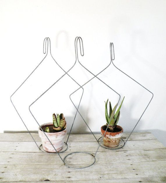 i like the idea of these wire hanger inspired   vintage flower pot hangers.     available at experimental vintage .     via justina's...