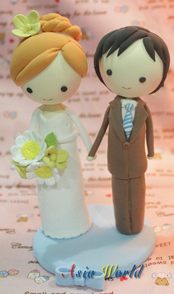 Wedding Cake topper, Clay Couple in Vintage wedding style, wedding clay doll decoration, rings holder in wedding, engagement. $57.50, via Etsy.