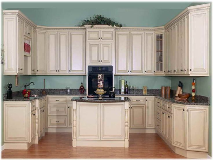 Great space designs paint antique white cabinets blue wall for Great kitchen wall colors