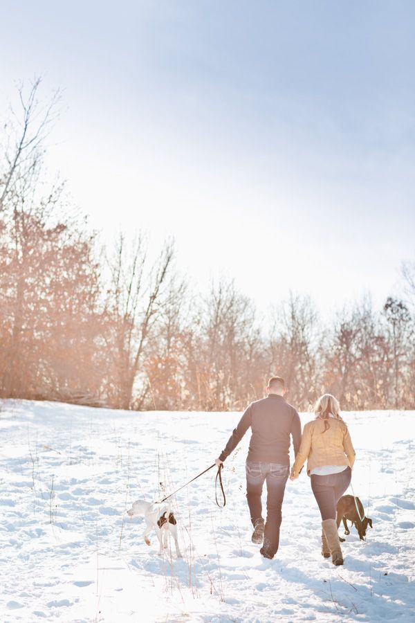 Minnesota winter engagement shoot with their cute dogs! Photo by Eileen K. Photography