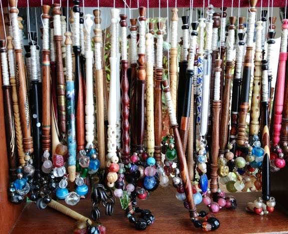 English (Midlands style) lace bobbins waiting for a lace pillow, some brass pins (a fisherman's wife might have used fish bones), and the other accoutrements of lace-making. Memories of the Ottawa lace guild ...